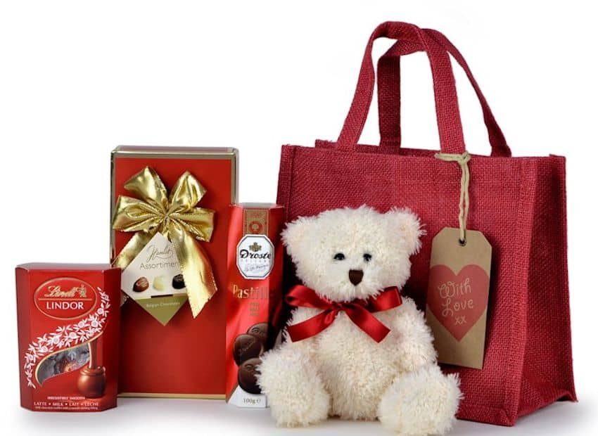a teddy bear and some other gifts