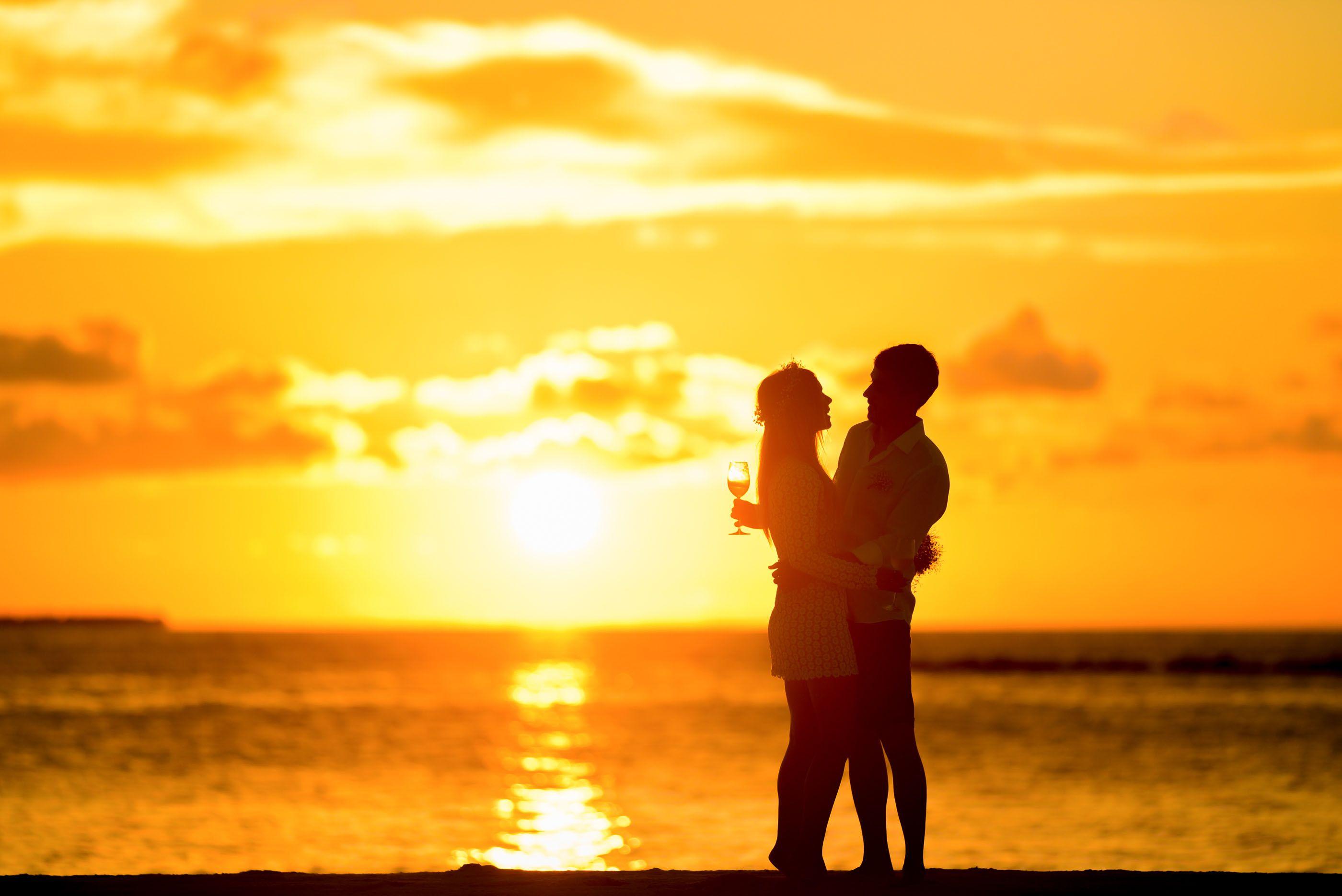 A Couple Enjoying The Sunset