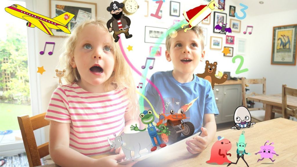 two kids having fun while learning with cartoons