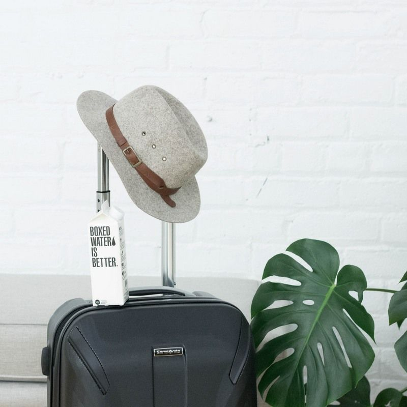a travel bag with a hat and some other things