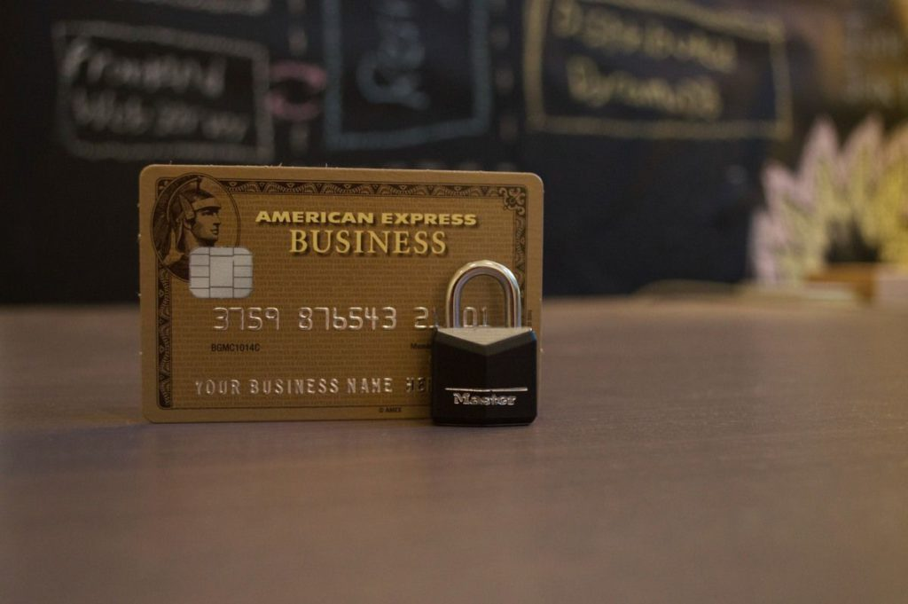 American Express Business Credit Card with a small lock on a table