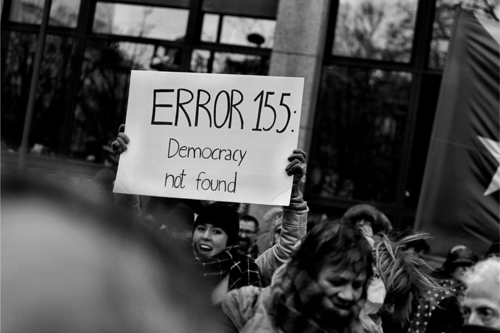 person holding a placard, democracy not found